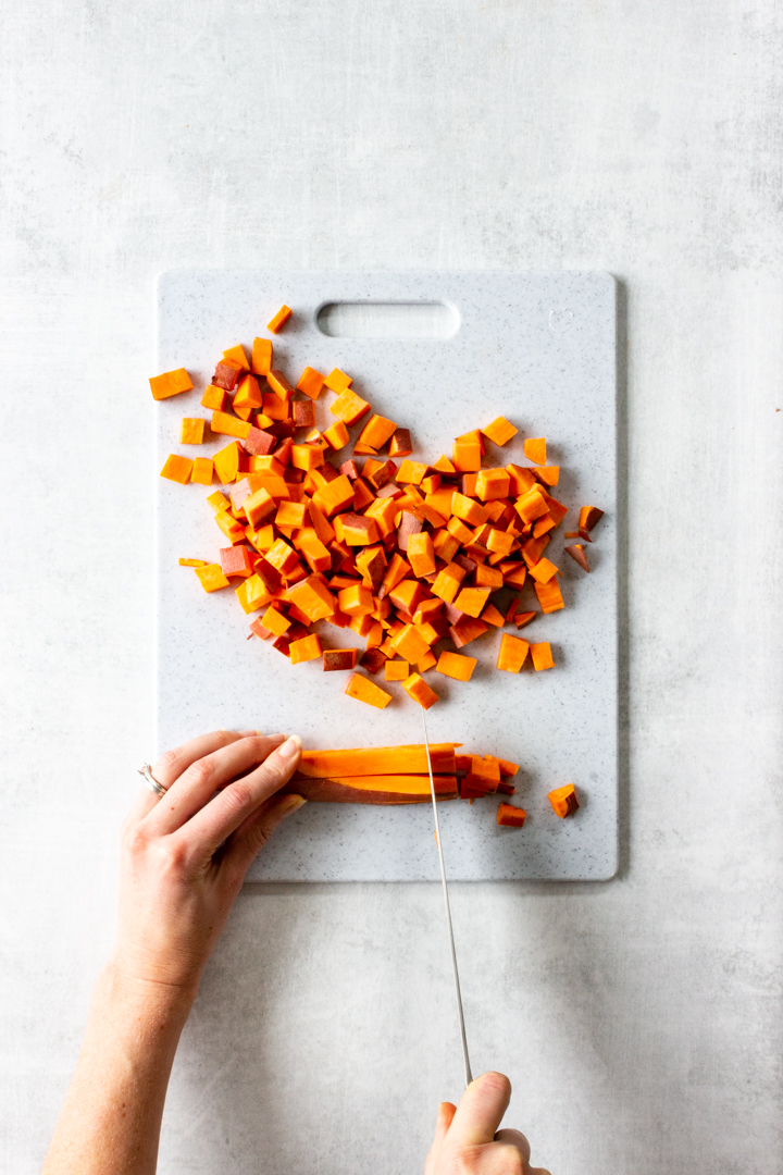 Once the sweet potato has been cut into strips, begin slicing along the strips every 1/2 inch resulting in diced sweet potato.