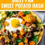 Sheet pan sweet potato hash with baked eggs, sliced avocado, and homemade romesco are served over baby spinach.
