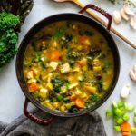 A large pot of chicken soup loaded with an assortment of veggies to aid in fighting off the flu.
