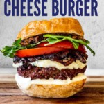 A big bacon blue cheese burger loaded with caramelized onions, tomatoes slices, arugula, Cambozola cheese, bacon jam, and roasted garlic aioli.