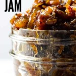 A mason jar filled with mouthwatering bourbon bacon jam.