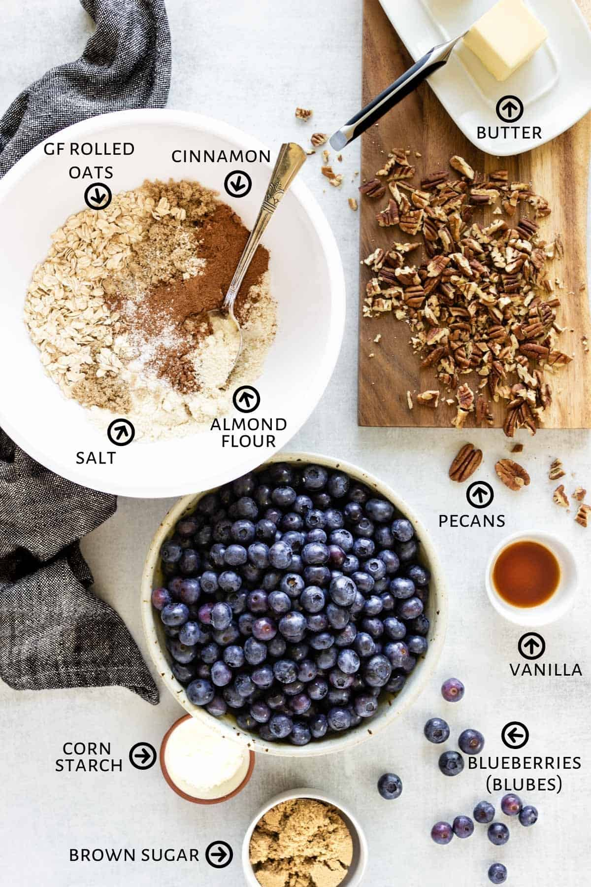 Ingredients for blueberry crisp are spread out on a counter.