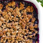 A baking dish of blueberry crisp straight out of the oven.