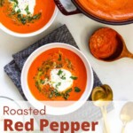A pot of creamy red pepper tomato soup, two bowls of soup, and a bowl of burrata.