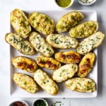 A platter of twice baked potatoes in four different flavors.
