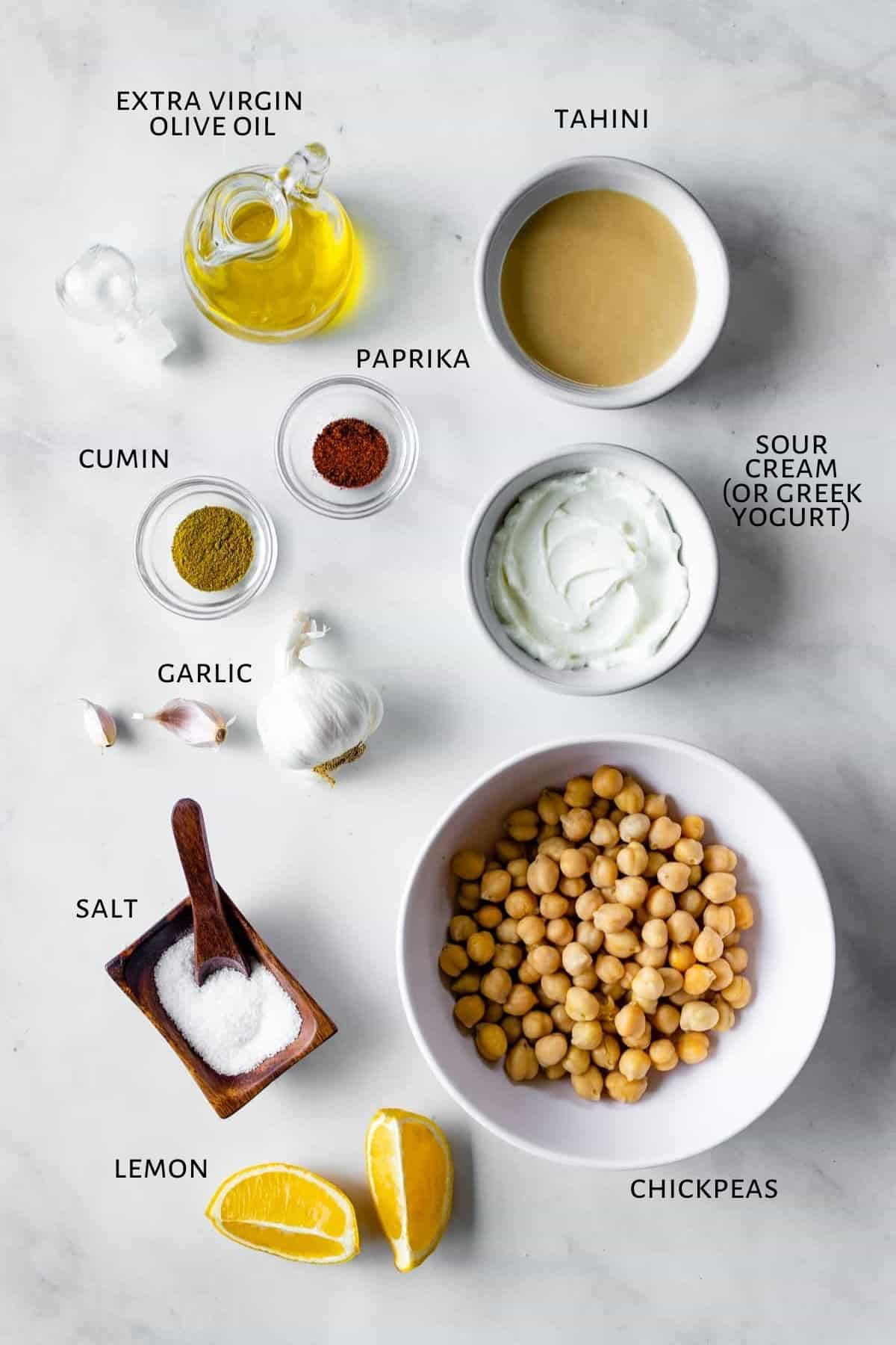 Ingredients for hummus are laid out on a counter.