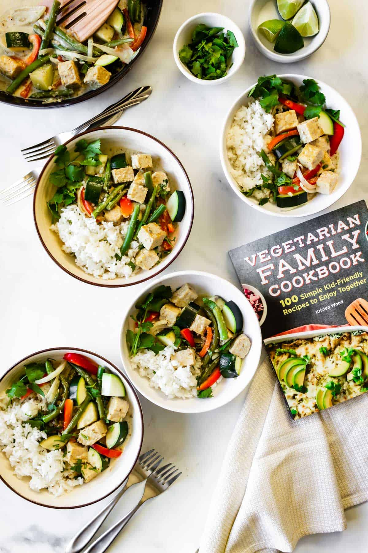 Tempeh green curry rice bowls and a cookbook.