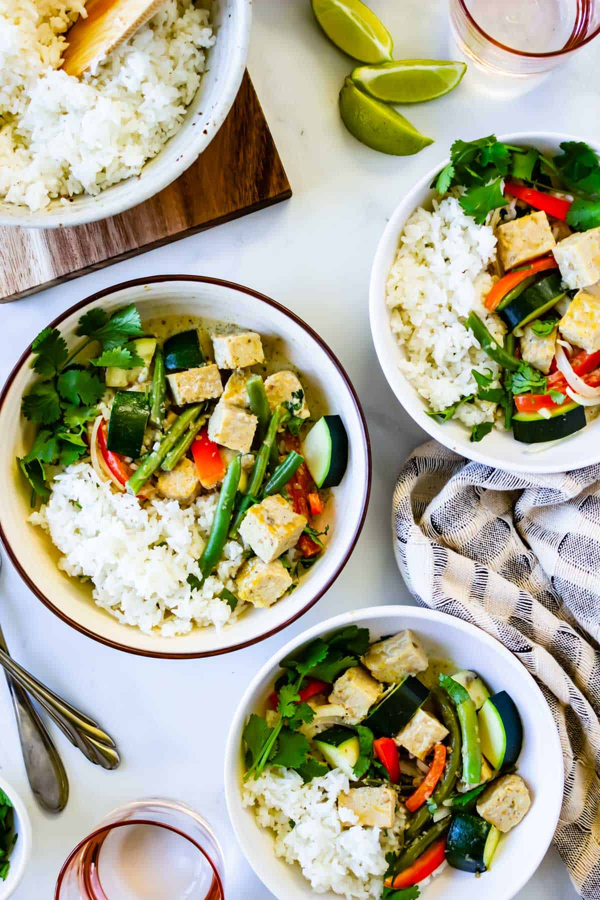 Bowls of Thai-style tempeh green curry.