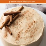 An oatmeal cake with cinnamon cream cheese frosting and decorated with cinnamon sticks.