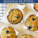 A muffin pan with fresh baked blueberry banana muffins.