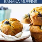 A muffin sits on a plate and two muffins are stacked on top of each other.