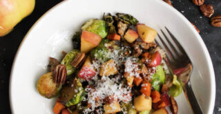 Pan-roasted brussels sprouts with Honeycrisp apples, pecans, and sausage.